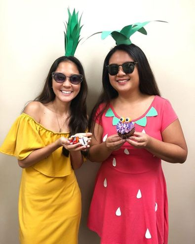 Two girls wearing sunglasses for Halloween.