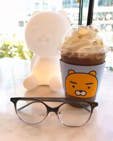 Photo of Lafont Paris eyeglasses in front of a bear drink.