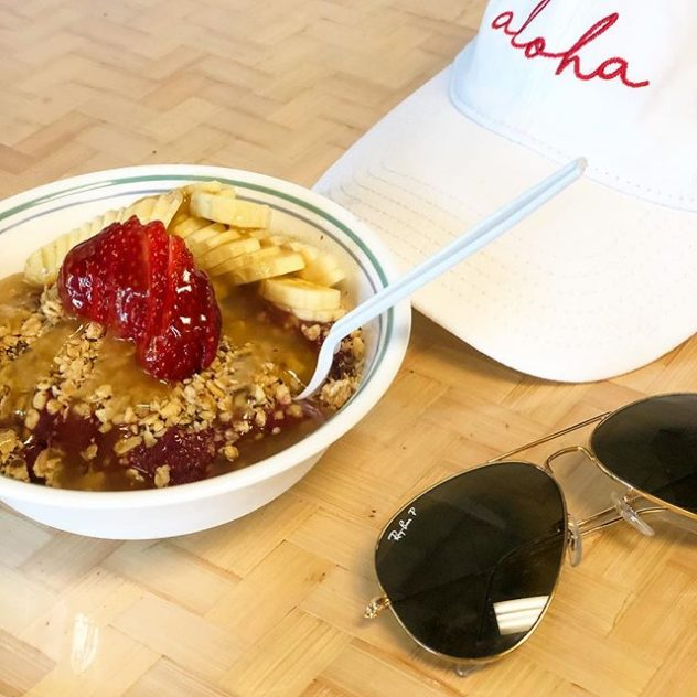 Ray Ban sunglasses with an acai bowl.